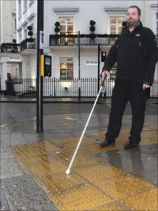 Man walking with white stick