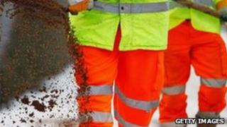 Council workers spread grit during the winter snow