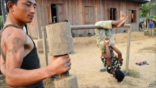 Maoist combatants exercise during physical training hours in Shaktikhor camp in Chitwan, 80km south-west of Kathmandu