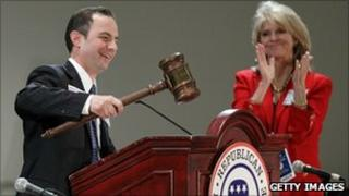 Reince Priebus receiving applause from Republican National Committee Secretary Sharon Day