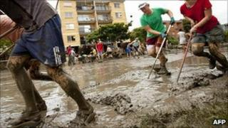 Residents and volunteers work together to clean up the homes and streets of the West End area of Brisbane