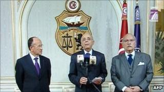 A grab from Tunisian TV showing Tunisian Prime Minister Mohammed Ghannouchi (C), Abdallah Kallel (L), president of the Chamber of Advisers of Tunisia and the President of the Tunisian Parliament Fouad Mbazaa addressing the nation on 14 January 2011