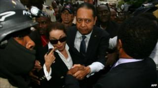 "Former Haitian president Jean-Claude ""Baby Doc"" Duvalier and his wife Veronique Roy depart court on 18 January 2011"