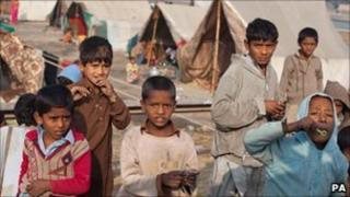 Children at a camp for flood victims along the road from Dadu, in Pakistan's Sindh province