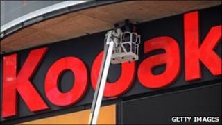 Workers fix Kodak sign