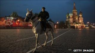 A Turkmen soldier rides a white Akhal-Teke horse during a Victory Day parade rehearsal on Red Square in Moscow, Russia on May 2, 2010.