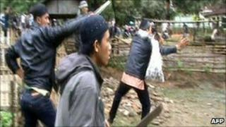 video grab made available 7 Feb by Human Rights Watch shows villagers attacking members of minority Ahmadiyah Islamic sect in Pandeglang, Banten province, on February 6, 2011