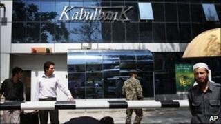 Men walk outside Kabul Bank