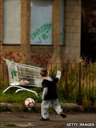 Boy in run-down Glasgow street