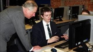 Prince Charles talks to Kristofer Anstey, then 14, who was working on pump designs for a Rolls Royce engine during a visit to the JCB Academy in 2011