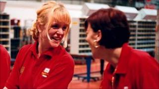 Royal Mail workers laughing