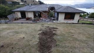 House hit by a boulder in Lyttelton, new Zealand, on 24 February 2011