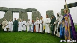 Pagans in traditional costumes at Stonehenge in Somerset
