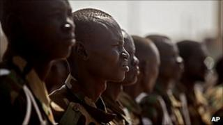 Southern Sudanese soldiers await the arrival of Malawi's President at the airport in the southern Sudanese capital of Juba on 26 January 2011