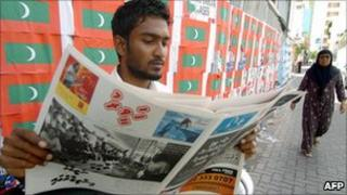 Maldivian man reading newspaper