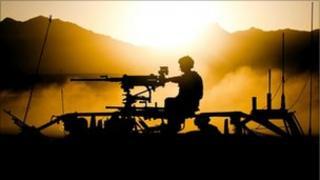 Silhouette image of Royal Marines in Afghanistan