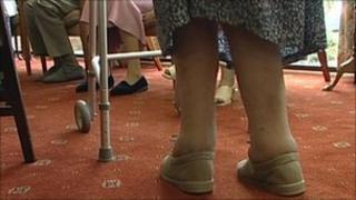 Elderly woman with walking frame