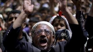 Anti-government protesters react during a demonstration in Sanaa, Yemen, 14 March 2011