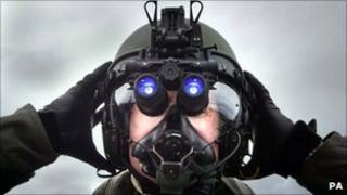 RAF pilot wearing night vision goggles
