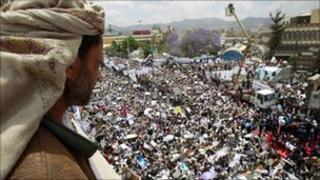 "A supporter of Yemen""s President Ali Abdullah Saleh looks at fellow supporters attending a rally at the Tahrir Square in Sanaa March 25, 2011"