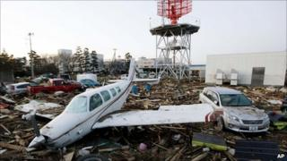 A light aircraft sits amongst the debris from the 11 March tsunami at Sendai Airport near Sendai, Miyagi prefecture