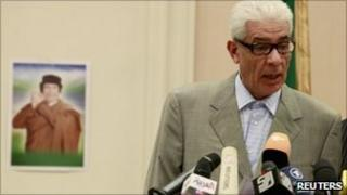 Libya's Foreign Minister Moussa Koussa speaking at a press conference