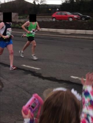 Police think the bomb had already been planted under Constable Ronan Kerr's black Ford Mondeo (top right) when these runners passed close to it