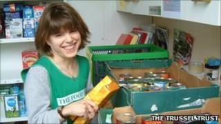 Volunteer sorting donated food
