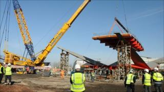 Part of bridge being lowered into place