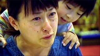 Keiko Niinuma and one of her children