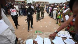 People watching the votes being counted at the parliamentary elections