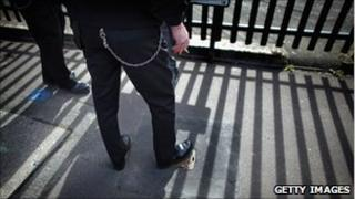 A prison officer stands outside Birmingham Prison, March 2011
