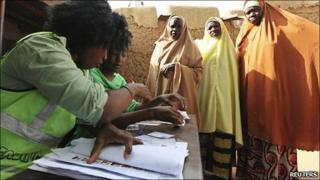Voters queue to cast their ballots at Daura, in Katsina state, in northern Nigeria 16 April 2011