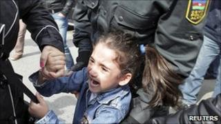 "Girl taken away in Baku after shouting ""freedom"". File photo"