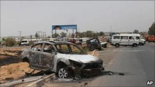 A charred vehicle after rioting in Kaduna, Nigeria, 19 April