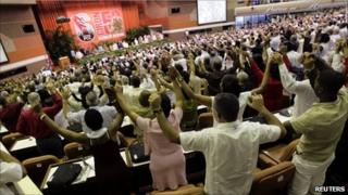 """Delegates sing """"The International"""" at the end of the closing ceremony of the sixth Cuban Communist Party (PCC) Congress in Havana, 19 April, 2011"""