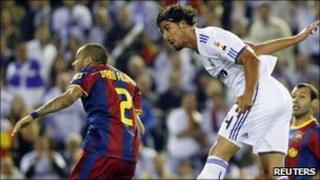"""Real Madrid's Sami Khedira (R) fights for the ball with Barcelona""""s Dani Alves"""