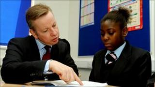 Michael Gove with a pupil in London