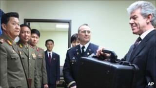 North Korean officials hand over remains of pilot to British ambassador Peter Hughes