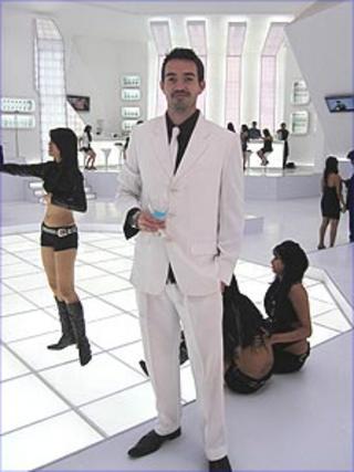 Howard Johnson in white suit on set