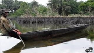 A man paddling a canoe in Rivers state, Nigeria