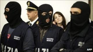 Italian policemen attend a press conference after a mafia leader's arrest on 2 May 2011
