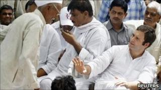 Rahul Gandhi gestures to a villager during his visit to Parsaul village on 11 May 2011