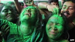 Trinamool Congress party supporters celebrate outside the residence of party leader Mamata Banerjee in Calcutta, on May 13, 2011.