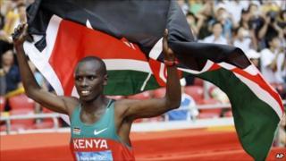 Aug 24, 2008 file photo, Kenya's Samuel Kamau Wanjiru celebrates winning the gold during the men's marathon at the Beijing 2008 Olympics