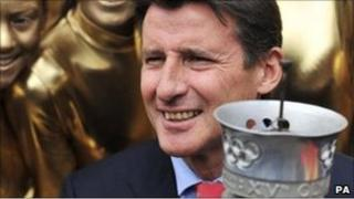 London 2012 chairman Lord Coe holding an Olympic Torch