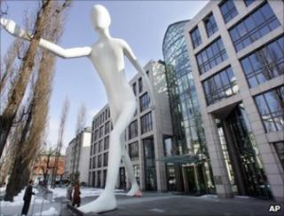 The sculpture Man Walking by US artist Jonathan Borofsky stands in front of the headquarters of Munich Re AG in Munich, March 2006