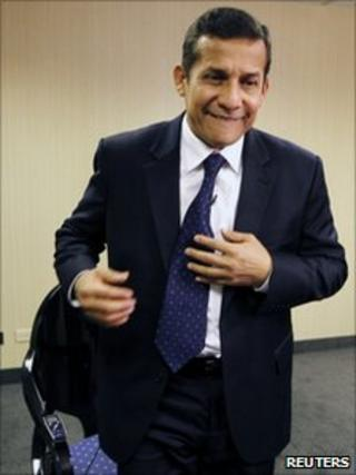 Ollanta Humala leaves after an interview with Reuters
