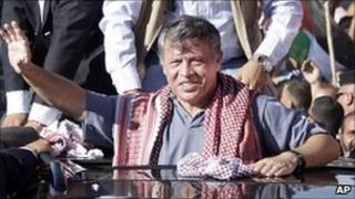 King Abdullah waves to crowds in Amman, Jordan (11 June 2011)