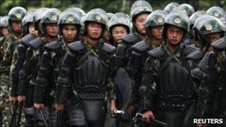 Riot police patrol on a street in the township of Xintang in Zengcheng near the southern Chinese city of Guangzhou June 13, 2011